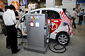 May 131, 2012, Tokyo, Japan - A visitors read the electric car specifications. The Smart Grid Exhibition and Automotive Next Industry Fair 2012 shows the next generation of vehicles and manufacturing working with eco energy, from May 30th. to June 1st. at Tokyo Big Site.