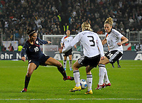 Carli Lloyd (10) battles beween Saskia Batusiak and Kim Kulig. US Women's National Team defeated Germany 1-0 at Impuls Arena in Augsburg, Germany on October 29, 2009.