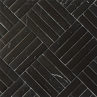 Clark, a stone mosaic, shown in Nero Marquina with a Della Mano finish, is part of the Ann Sacks Beau Monde collection sold exclusively at www.annsacks.com
