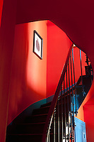 Looking up the wooden staircase that has been painted bright blue