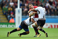 Nick Blevins of Canada is double-tackled. Rugby World Cup Pool D match between Canada and Romania on October 6, 2015 at Leicester City Stadium in Leicester, England. Photo by: Patrick Khachfe / Onside Images