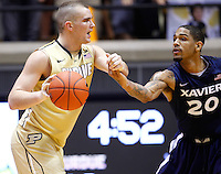 WEST LAFAYETTE, IN - DECEMBER 01: D.J. Byrd #21 of the Purdue Boilermakers holds the ball as Justin Martin #20 of the Xavier Musketeers defends at Mackey Arena on December 1, 2012 in West Lafayette, Indiana. Xavier defeated Purdue 63-57. (Photo by Michael Hickey/Getty Images) *** Local Caption *** D.J. Byrd; Justin Martin