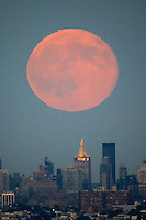 The Blue moon rises over the middle Manhattan while it is seen from New Jersey.  07/31/2015. Eduardo MunozAlvarez/VIEWpress