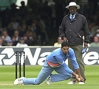 .29/06/2002.Sport - Cricket - .NatWest triangler Series England - Sri Lanka - India.England vs india 50 overs.  Lord's ground.England batting -  Yuvraj Singh getting down to a returned ball from Ronnie Irani - Umpire Steve Bucknor look's on...