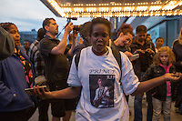 NEW YORK APRIL 21: Woman wears a T-shirt with a photograph of Prince at a makeshift memorial place created outside Apollo Theatre in Harlem, New York City, Friday, April 21, 2016. The pop star die a few hours ago at the age of 57.Photo by VIEWpress/Maite H. Mateo