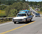 BARTON VT - 144th Orleans County Fair in the scenic Northeast Kingdom village of Barton, Vermont broke the Guinness World Records of the longest Cadillac Parade in history with 298 cars Wednesday in Barton Vermont. 1967 Cadillac ambulance driven by Jacob Fournier from Lunenburg Vermont..