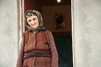 A woman who was displaced from Nagorno-Karabakh outside her current home in Sumqayit, Azerbaijan, on Friday, Nov. 4, 2005.
