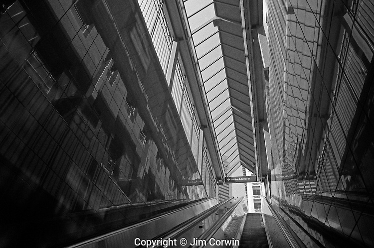 Underground escalator taking people up to city street downtown Seattle Washington State USA