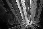 Underground escalator taking people up to city street downtown Seattle Washington State USA