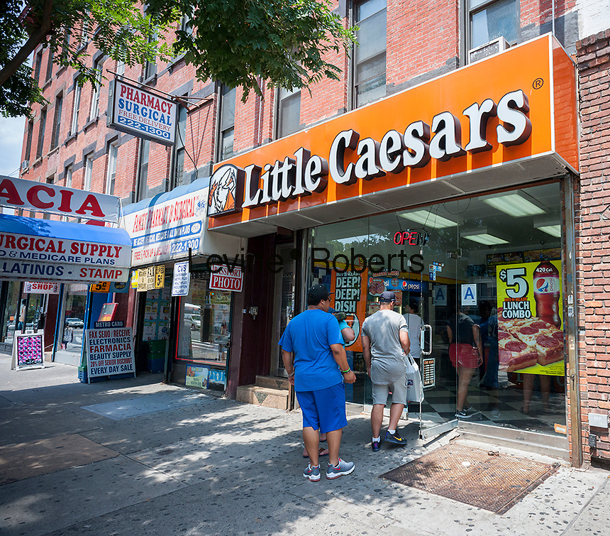 A branch of the Little Caesars restaurant chain in Harlem in New York on Saturday, July 16, 2016. (© Richard B. Levine)