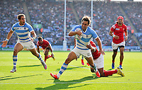 Nicolas Sanchez of Argentina looks to reach the Tonga try-line. Rugby World Cup Pool C match between Argentina and Tonga on October 4, 2015 at Leicester City Stadium in Leicester, England. Photo by: Patrick Khachfe / Onside Images