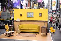 """#SetintheStreet, an interactive film set in the middle of Times Square in New York on Friday, April 17, 2015. Created by Justin Bettman, the public art project made out of found items allows visitors to pose for photos in a """"film still"""". The project in Times Square is in collaboration with the Tribeca Film Festival. Between uses found materials and hopes that #SetintheStreet will cause people to re-evaluate their thinking about trash.  (© Richard B. Levine)"""