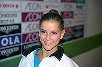 """September 9, 2009; Mie, Japan;  Lieselotte Diels of Belgium poses with big smile the press """"mixed zone"""" at 2009 World Championships Mie. Photo by Tom Theobald ."""