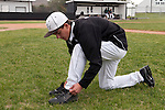 Vale's Branden Holloway changes into his cleats before the start of the 3A Oregon State Baseball Championships first round game against Rogue River on May 25, 2011 at Cammann Field, Vale, Oregon.