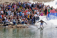 """Cushing Classic at Squaw Valley 10"" - Photograph of a skier crossing a pond during the Cushing Classic at Squaw Valley, USA."