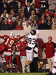 25 November 2006: East Carolina's Steven Rogers (83) catches a pass after getting past NC State's Garland Heath (19). The East Carolina University Pirates defeated the North Carolina State University Wolfpack 21-16 at Carter Finley Stadium in Raleigh, North Carolina in an NCAA Division I College Football game.