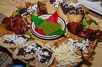 Tentación, a sampler platter, from Casa Oaxaca in Santa Ana, CA.  Included are 3 quesadillas (1:00), chorizo (3:00), 3 chicken taquitos (4:00), string cheese (5:30), 3 memela (7:00), cecina (9:00), 3 molotes (10:00), tasajo (11:30), & guacamole (center).  This was a great start to the meal.