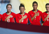 14 August 2004:   (From left to right) Aly Wagner, Mia Hamm, Shannon Boxx and Cat Reddick during national anthem before the game against Brazil at Kaftanzoglio Stadium in Thessaloniki, Greece.  USA defeated Brazil, 2-0.  Credit: Michael Pimentel / ISI