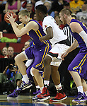 Louisville's Chinanu Onuaku (32) guards Northern Iowa State's Nate Buss (14)  during the 2015 NCAA Division I Men's Basketball Championship's March 22, 2015 at the Key Arena in Seattle, Washington.  Louisville beat Northern Iowa State 66-53 to advance to the Sweet 16.  ©2015. Jim Bryant Photo. ALL RIGHTS RESERVED.