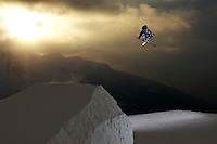 Charles Gagnier creative ski grabs on a huge jump for the salomon photo and film shoot