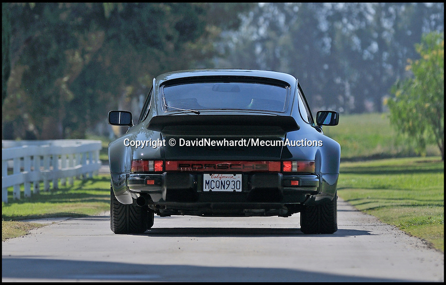 BNPS.co.uk (01202 558833)<br /> Pic: DavidNewhardt/MecumAuctions/BNPS<br /> <br /> The Great Escaper....Steve McQueen's Porsche Turbo - customised to help him outrun the cops...and the press.<br /> <br /> The last car bought by Hollywood badboy Steve McQueen before his untimely death 35 years ago which he customised to help him outrun paparazzi photographers has been put up for sale.<br /> <br /> McQueen, a renowned petrolhead, had the Porsche 930 Turbo Carrera custom made in 1976, four years before he died from cancer aged 50.<br /> <br /> He was one of the hottest stars on the planet at the time, and at his request the turbo-charged sports car was fitted with a list of added extras including a special switch that turned off the rear lights to make it hard to spot at night.<br /> <br /> The car is being sold by collector and restorer Mike Regalia at Mecum Auctions in Monterey, California.<br /> <br /> Experts there are remaining tight-lipped about how much they expect it to fetch - but it is likely to be hundreds of thousands of pounds
