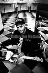 NEW YORK - MARCH 1993:  American rock guitarist Tom Morello, of bands Rage Against the Machine and Audioslave poses for a portrait holding his guitar in March 1993 in New York City, New York. (Photo by Catherine McGann)Copyright 2010 Catherine McGann