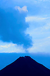 The very active Arenal Volcano looms over the town of La Fortuna, Costa Rica at dawn.