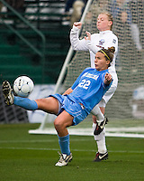 North Carolina defender Amber Brooks (22) attempts a bicycle kick. North Carolina defeated Stanford 1-0 to win the 2009 NCAA Women's College Cup at the Aggie Soccer Stadium in College Station, TX on December 6, 2009.