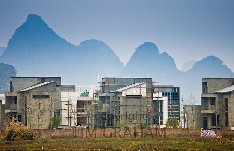 Hotel complex under construction by the Li River between Guilin and Yangshuo, China