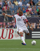 DC United forward Maicon Santos (29) shoots the ball. In a Major League Soccer (MLS) match, DC United defeated the New England Revolution, 2-1, at Gillette Stadium on April 14, 2012.