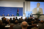 United States President Barack Obama addresses a meeting of the Libya Contact Group at the United Nations in New York, New York on Tuesday, September 20, 2011.  Chairman Mustafa Abdel Jalil of the Libyan Transitional National Council (TNC) and UN Secretary-General Ban Ki-Moon are in attendance.  From left to right at the table at left: Chairman Mustafa Abdel Jalil of the Libyan Transitional National Council (TNC) , UN Secretary-General Ban Ki-Moon, and the UN Under Secretary-General for the Depatment of Political Affairs (DPA) B. Lynn Pascoeat..Credit: Allan Tannenbaum / Pool via CNP