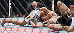 Dustin Poirer, white trunks, locks up Pablo Garza at Saturday's UFC on Fox event at the Honda Center.