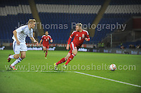 Juhani Ojala of Finland is about to challenge Simon Church of Wales during the Wales v Finland Vauxhall International friendly football match at the Cardiff City stadium, Cardiff, Wales. Photographer - Jeff Thomas Photography. Mob 07837 386244. All use of pictures are chargeable.