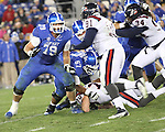 Junior offensive tackle Kevin Mitchell defends blocks Samford during the second half of the UK vs Samford at Commonwealth Stadium in Lexington, Ky., on Saturday, November 17th, 2012. Photo by Logan Douglas | Staff.