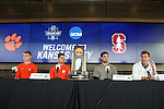 12 December 2015: Clemson head coach Mike Noonan (right) with (from right) Andrew Tarbell, Paul Clowes (ENG), and Kyle Fisher. The NCAA held a press conference at Three Points at the Sporting Kansas City offices one day before the Clemson University Tigers play the Stanford University Cardinal in a 2015 NCAA Division I Men's College Cup championship match.