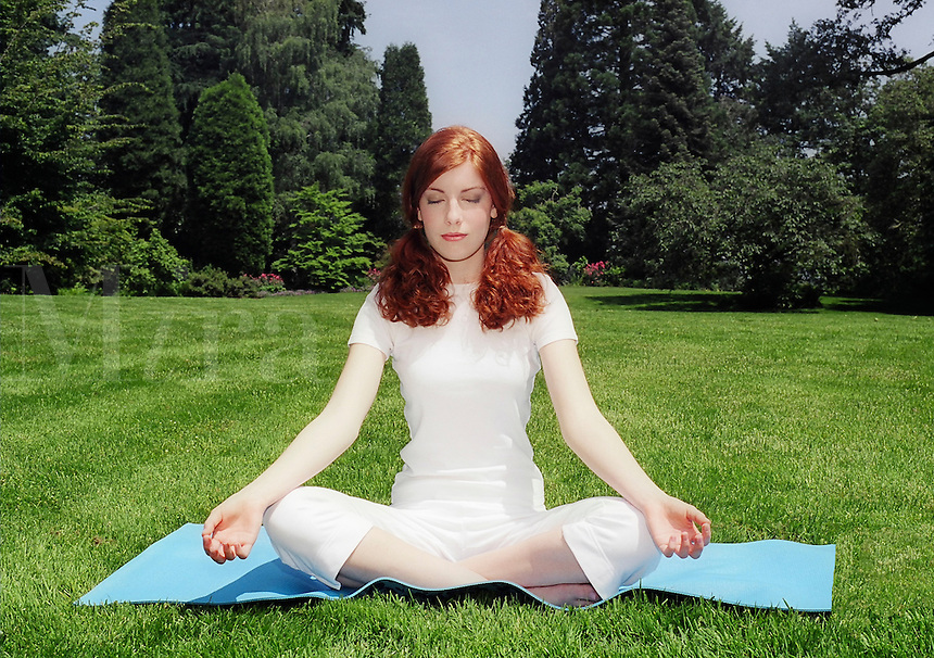 Young woman in yoga lotus position..MR