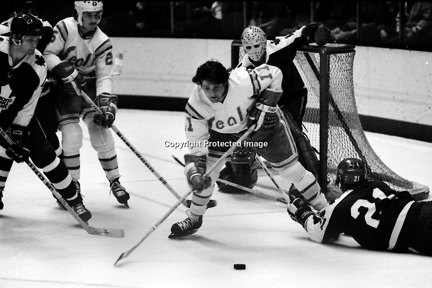 Toronto Maole Leafs Borje Salming dives to block Seals Ron Huston in front of goalie Gord McRae. (1975 photo/Ron Riesterer)