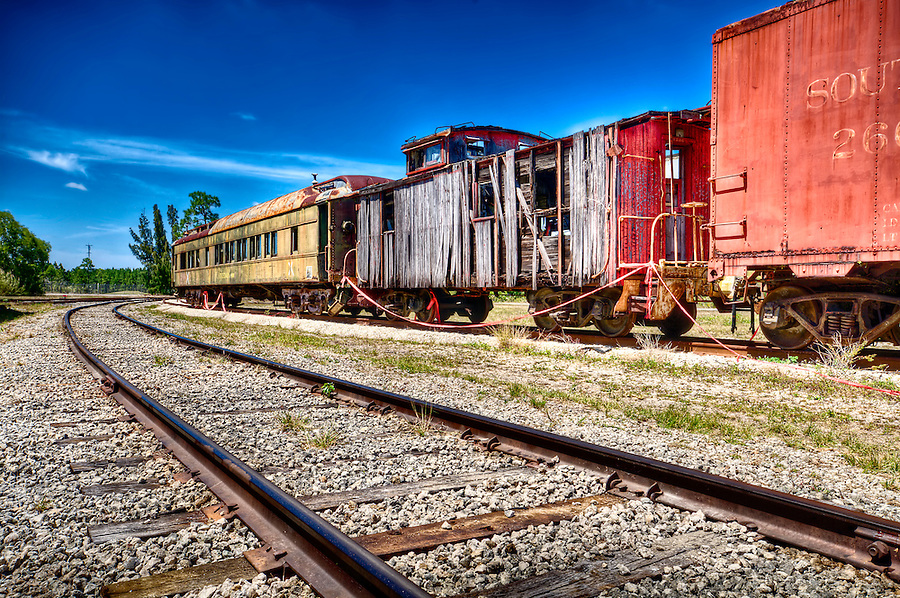 Old and rusted wagon trains over a railway.