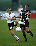 Kristine Lilly (13) and Shannon Boxx (5) at Mitchel Athletic Complex in Uniondale, New York on 8/1/03 during a game between the New York Power and Boston Breakers. The Breakers won the game 3-2.