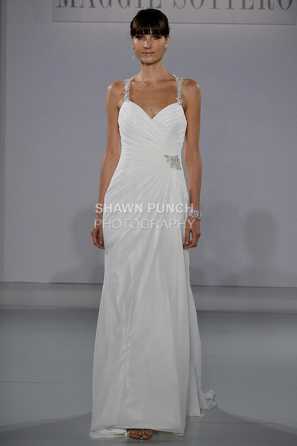 Model walks runway in a Delanie wedding dress from the Sottero and Midgley Spring 2013 collection, at The Couture Show, during New York Bridal Fashion Week, on October 14, 2012.
