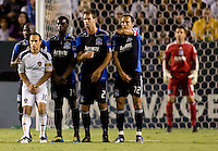 San Jose Earthquakes players Ike Opara (6), Brandon McDonald (14), Bobby Burling (2), Ramiro Corrales (12) and LA Galaxy midfielder Landon Donovan (10) make a wall in front of goalkeeper Jon Busch (18). The LA Galaxy and the San Jose Earthquakes played to a 2-2 draw at Home Depot Center stadium in Carson, California on Thursday July 22, 2010.
