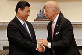 United States Vice President Joe Biden (R) and Vice President Xi Jinping of China shake hands before an expanded bilateral meeting with other U.S. and Chinese officials in the Roosevelt Room at the White House February 14, 2012 in Washington, DC. While in Washington, Vice President Xi will meet with Biden, President Barack Obama and other senior Administration officials to discuss a broad range of bilateral, regional, and global issues.  .Credit: Chip Somodevilla / Pool via CNP.Credit: Chip Somodevilla / Pool via CNP
