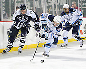 Nick Sorkin (UNH - 21), Joey Diamond (Maine - 39), Brian Flynn (Maine - 10) - The University of Maine Black Bears defeated the University of New Hampshire Wildcats 5-4 in overtime on Saturday, January 7, 2012, at Fenway Park in Boston, Massachusetts.
