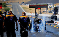 Jul. 17, 2010; Sonoma, CA, USA; NHRA top fuel dragster driver Troy Buff does a burnout during qualifying for the Fram Autolite Nationals at Infineon Raceway. Mandatory Credit: Mark J. Rebilas-