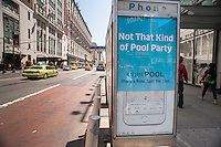 An advertisement on a telephone kiosk for UberPool ridesharing in Midtown in New York on Thursday, May 14, 2015. UberPool has recently come to the rescue of those stranded in Williamsburg Brooklyn due to suspension of the L train on weekends. The ridesharing service is offering rides from the hipster neighborhood to Manhattan in the vicinity of the L train for the price of a subway fare. (© Richard B. Levine)