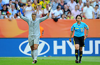 Hope Solo and referee Jacqui Melksham during the FIFA Women's World Cup at the FIFA Stadium in Dresden, Germany on July 10th, 2011.