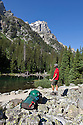 WY00611-00...WYOMING - Hiker in Cascade Canyon of Teton National Park.