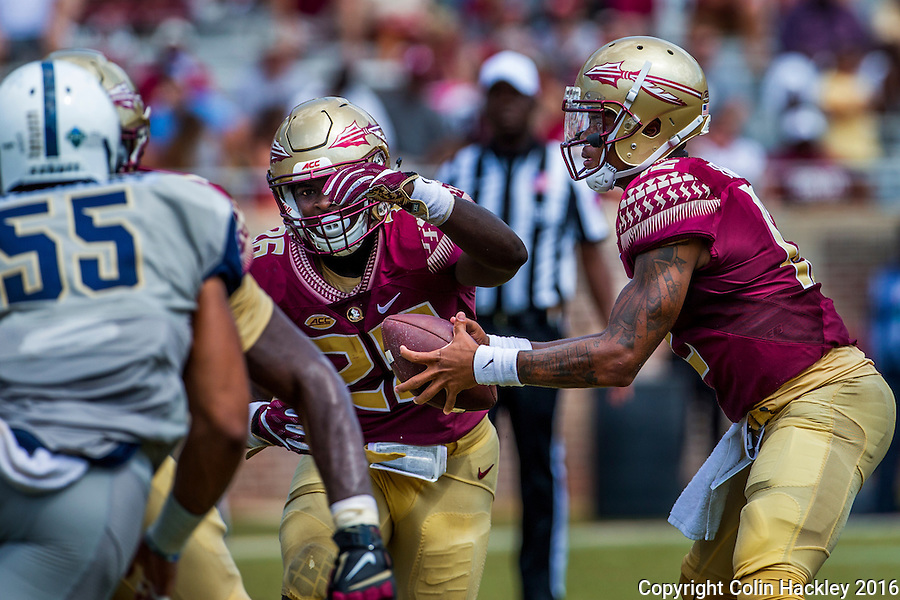 TALLAHASSEE, FLA 9/10/16-Florida State quarterback Deondre Francois, hands off to Johnathan Vickers during third quarter action against Charleston Southern, Saturday at Doak Campbell Stadium in Tallahassee. <br /> COLIN HACKLEY PHOTO