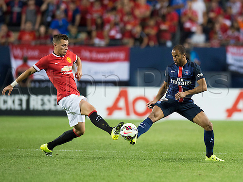 29.07.2015. Chicago, IL, USA. Manchester United midfielder Morgan Schneiderlin (28) and Paris Saint-Germain midfielder Lucas Moura (7) challenge for the ball during the Guinness International Champions Cup game between Manchester United and Paris Saint-Germain hosted at Soldier Field in Chicago, IL.