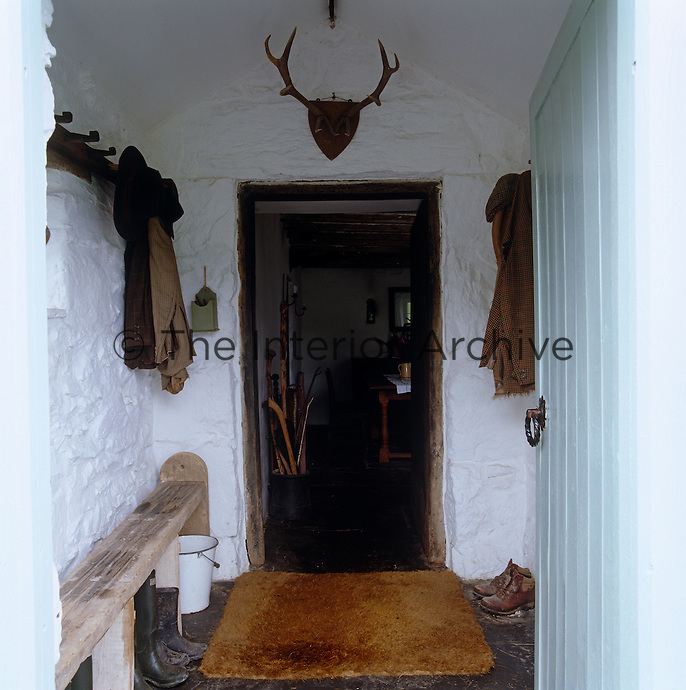 The entrance hall is a place to leave muddy boots and coats before entering the house